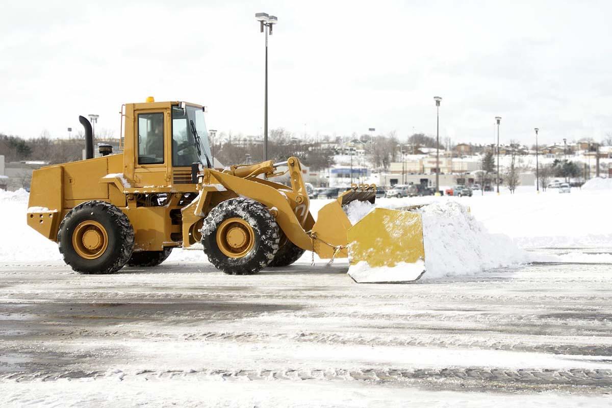 Bull Dozer Gathering Snow